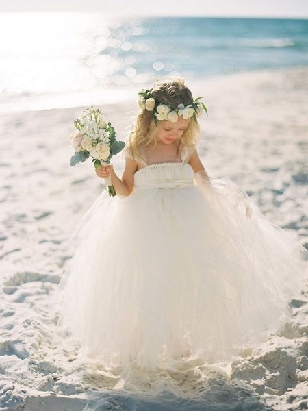Flower girl dresses that will turn them into little ladies for Floral beach wedding dresses